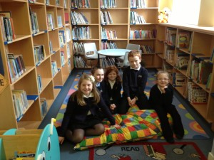 Our lovely new look library with the Pupil council members who organised it.