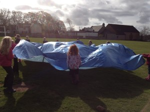 We explored how the wind affected different materials, and had the most fun with our tarpaulin because it was big but also very light.